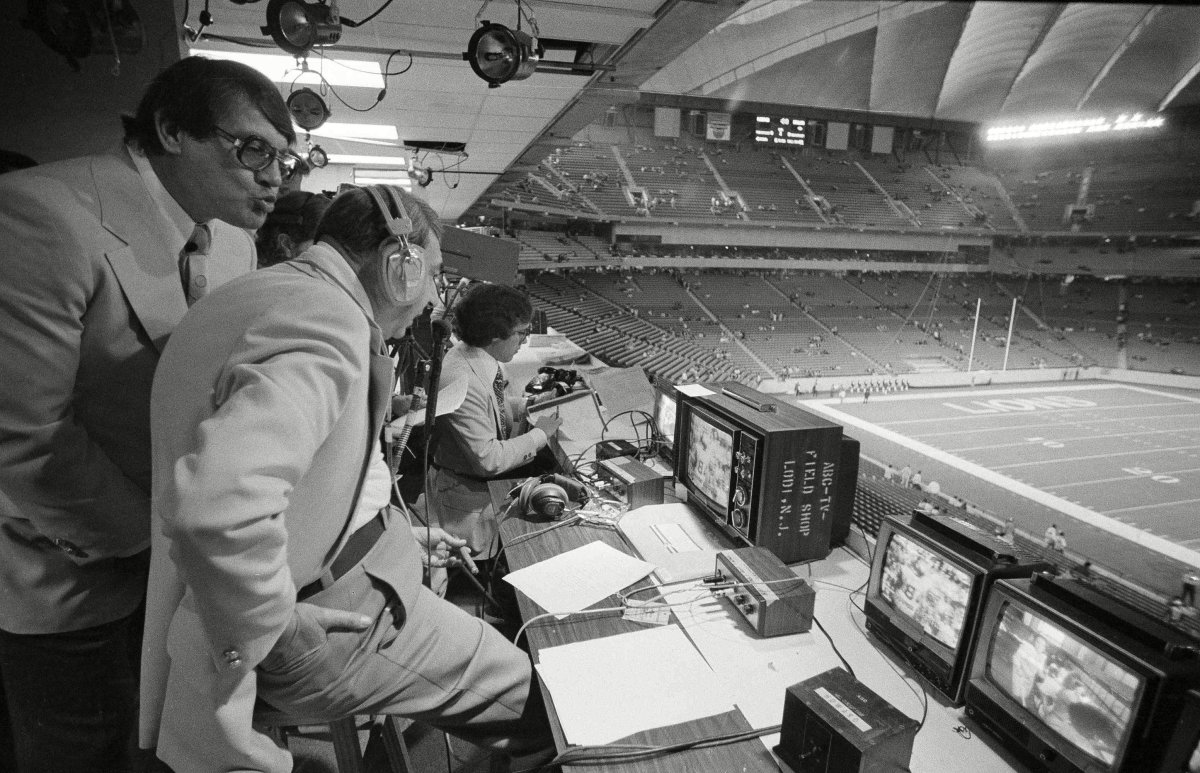Cosell (center), with later MNF partners Alex Karras (left) and Frank Gifford, in 1975.