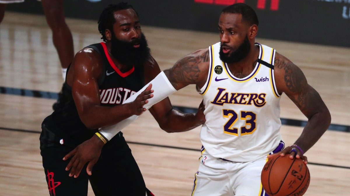 Los Angeles Lakers forward LeBron James (23) dribbles the ball around Houston Rockets guard James Harden (13) in the first half of game five of the second round of the 2020 NBA Playoffs at ESPN Wide W...