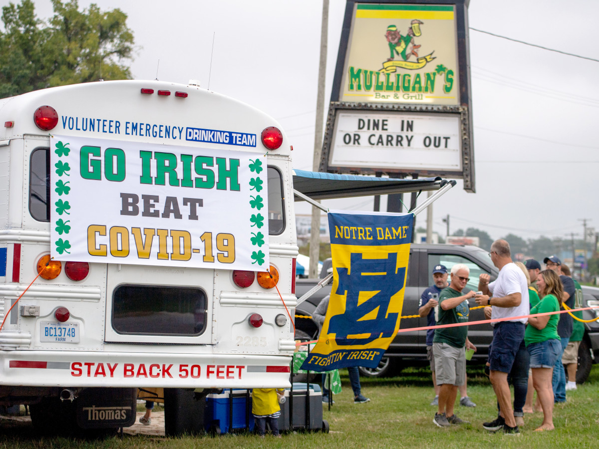 Sep 12, 2020; Notre Dame, Indiana, USA; Fans gather off-campus for the game between the Notre Dame Fighting Irish and the Duke Blue Devils at Notre Dame Stadium. Notre Dame limited seating capacity and banned tailgating on campus as part of its COVID-19 protocols.