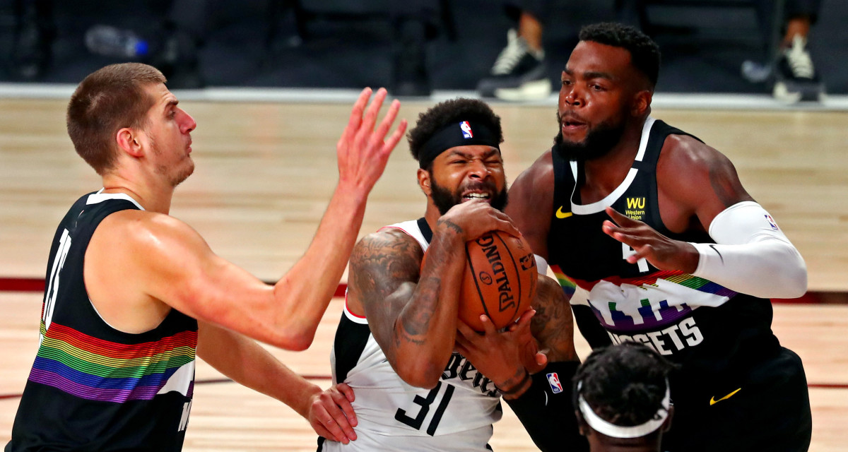 LA Clippers forward Marcus Morris Sr. (31) drives to the basket against Denver Nuggets forward Paul Millsap (4) during the first quarter in game six of the second round of the 2020 NBA Playoffs