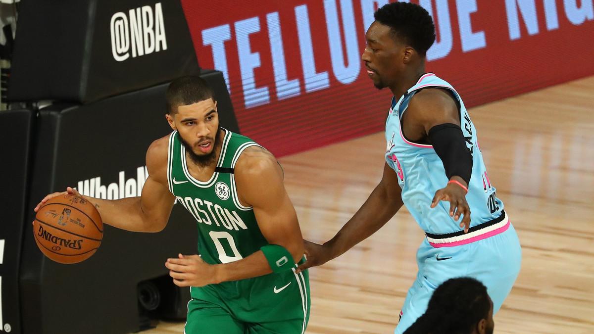 Boston Celtics forward Jayson Tatum controls the ball against Miami Heat forward Bam Adebayo in the second half of a NBA basketball game