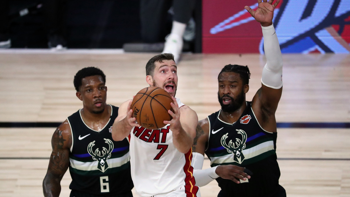 Miami Heat guard Goran Dragic shoots against Milwaukee Bucks guard Eric Bledsoe and guard Wesley Matthews during the first half of game two of the second round