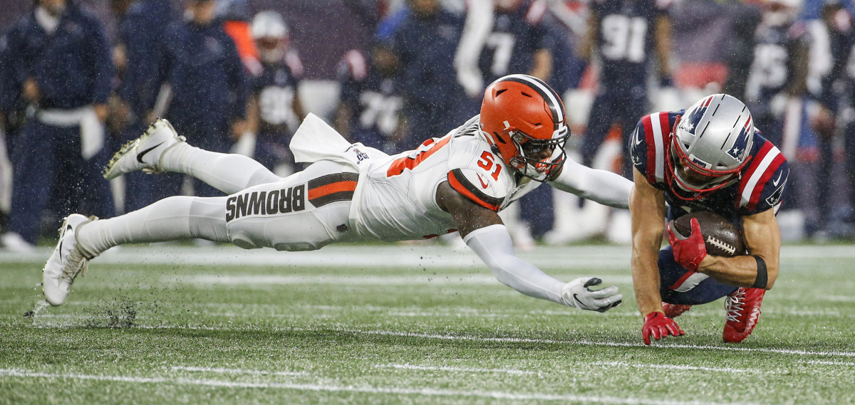 Browns linebacker Mack Wilson dives to tackle Patriots wide receiver Julian Edelman during a 2019 game. Wilson is the only starting linebacker to return to the Browns for the 2020 season.