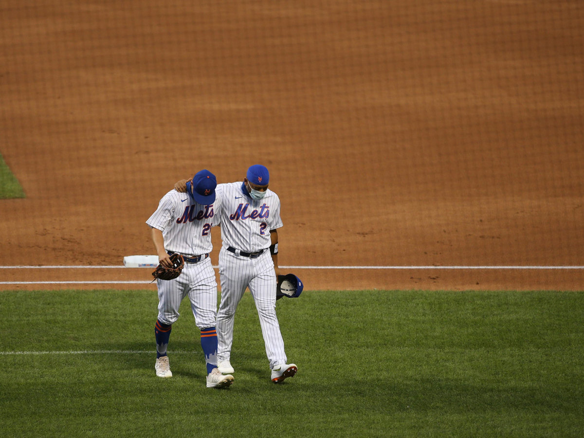 Dominic Smith walks off the field with a teammate