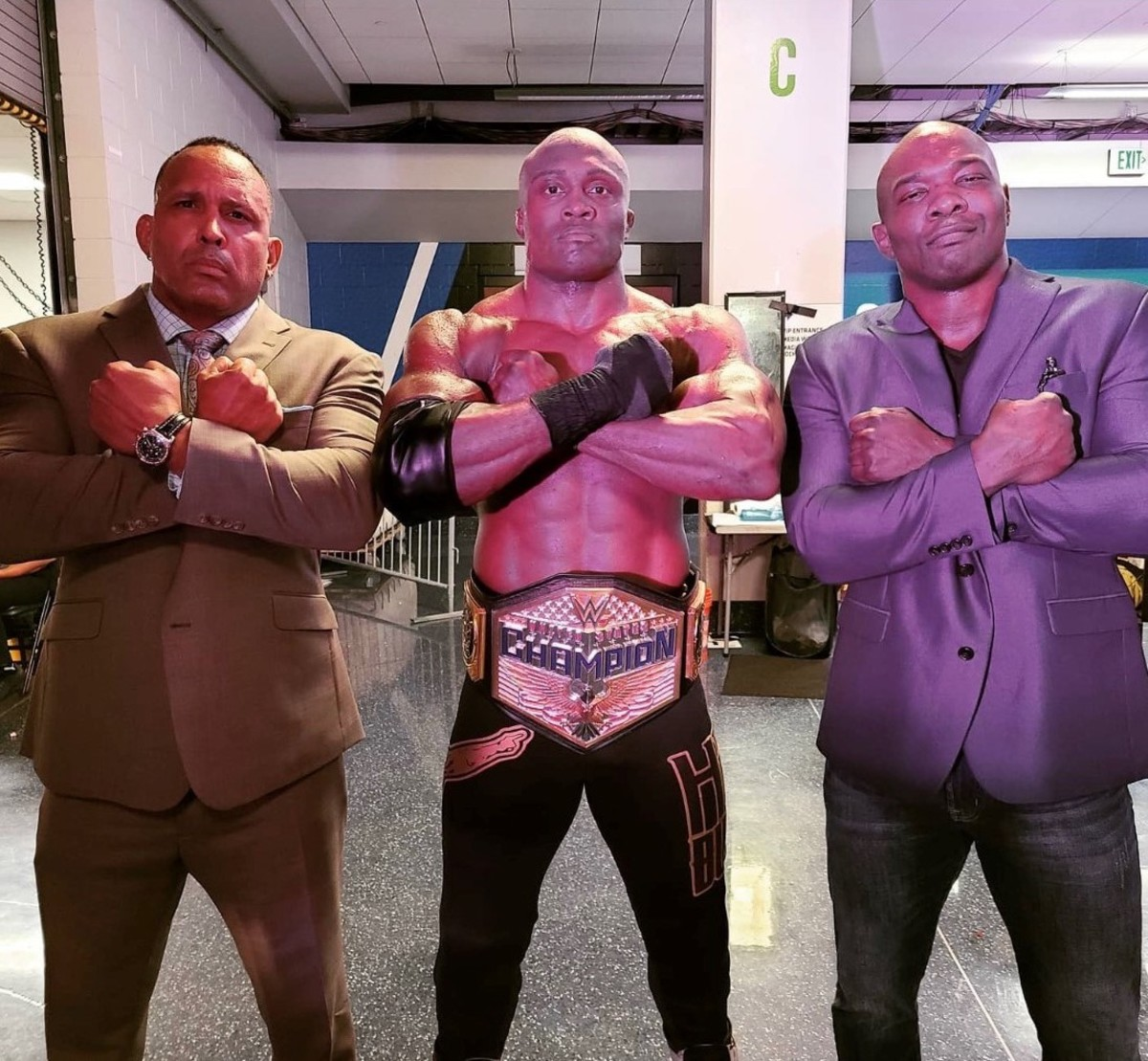 "WWE's Bobby Lashley, MVP and Shelton Benjamin do the Wakanda Forever salute from ""Black Panther"""