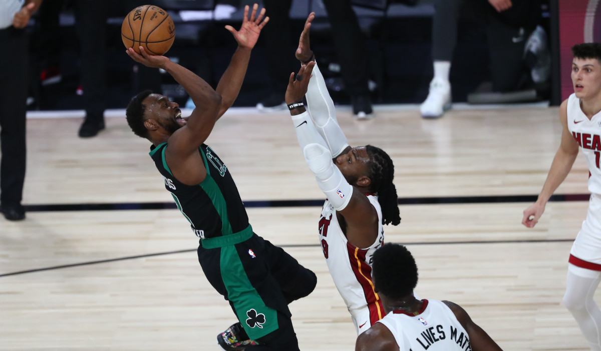 Boston Celtics guard Kemba Walker (8) goes up for a shot while Miami Heat forward Jae Crowder (99) defends during the second half in game one of the Eastern Conference Finals of the 2020 NBA Playoffs