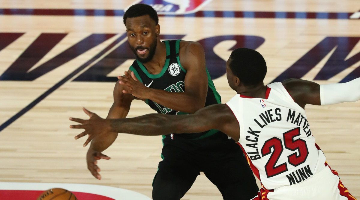 Boston Celtics guard Kemba Walker (8) passes the ball while Miami Heat guard Kendrick Nunn (25) defends during the second half in game one of the Eastern Conference Finals of the 2020 NBA Playoffs
