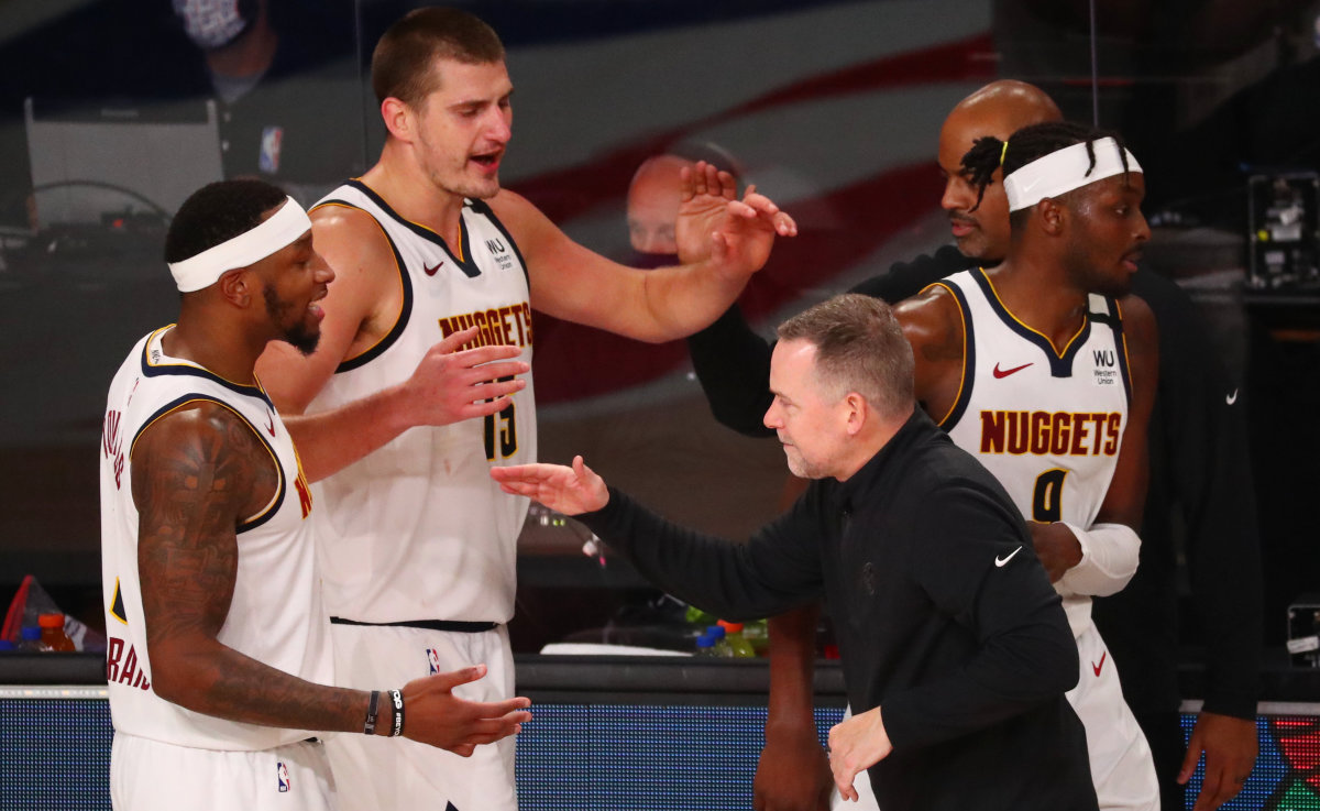 Denver Nuggets head coach Michael Malone celebrates with his team after defeating the Los Angeles Clippers in game seven of the second round of the 2020 NBA Playoffs