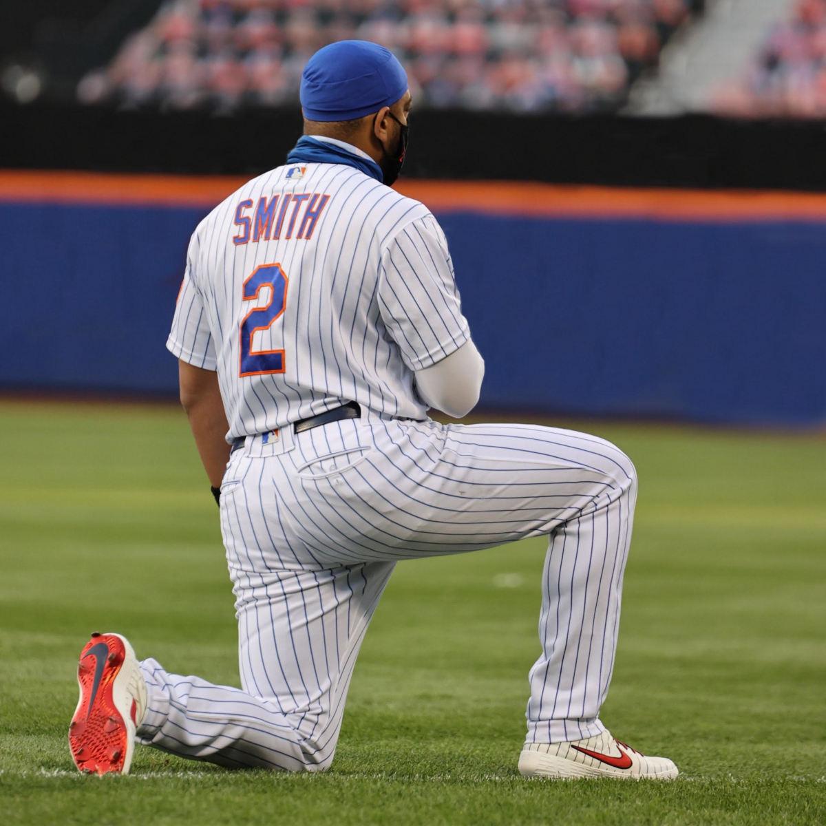 Dom Smith kneeling