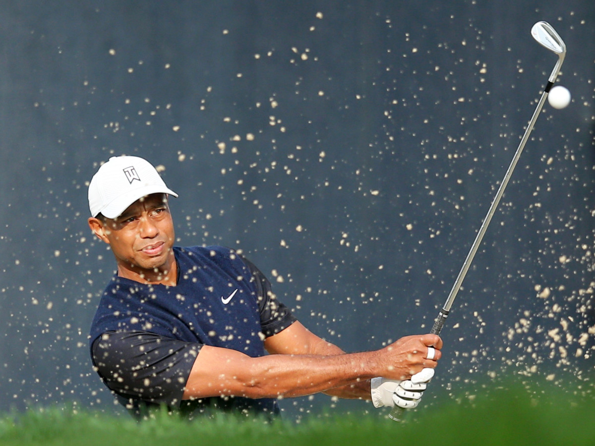 Sep 17, 2020; Mamaroneck, New York, USA; Tiger Woods hits from a sand trap onto the 3rd green during the first round of the U.S. Open golf tournament at Winged Foot Golf Club - West.
