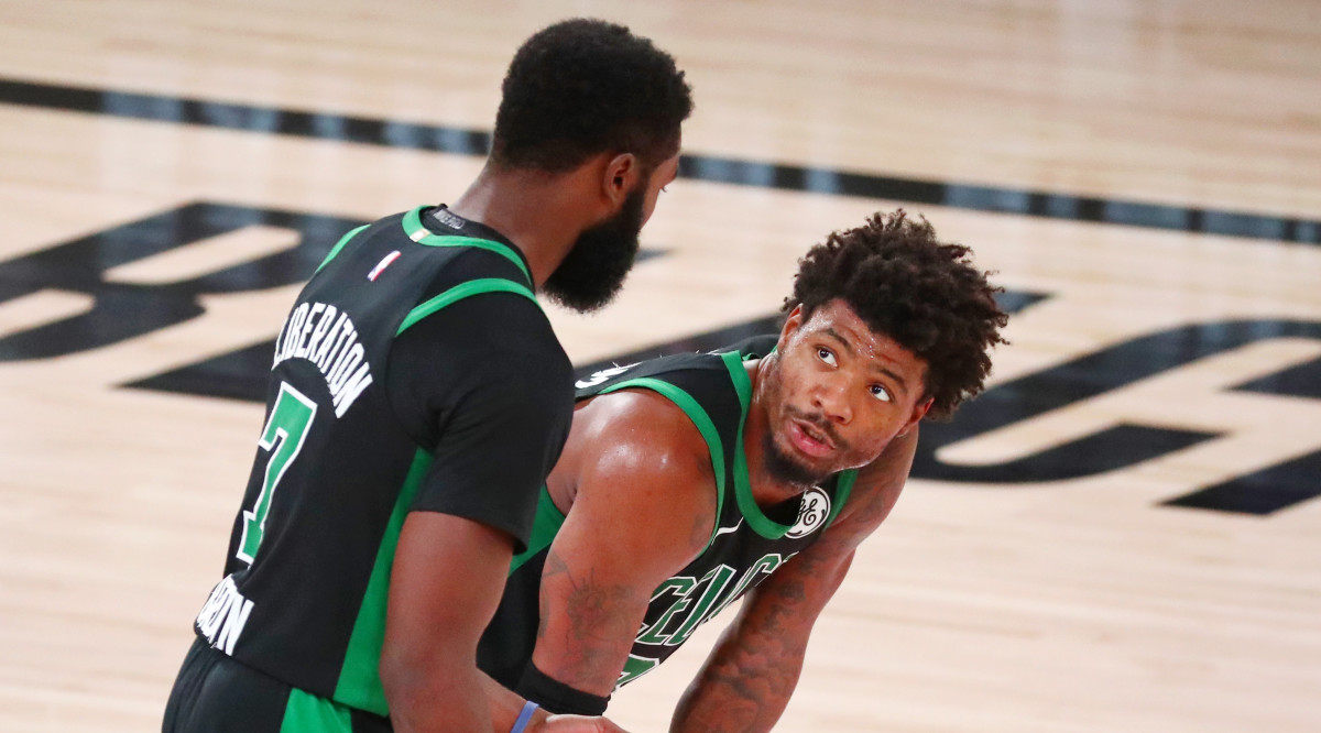 Boston Celtics guard Jaylen Brown (left) talks with guard Marcus Smart (36) during the fourth quarter of Game 2 of Eastern Conference Finals of 2020 NBA Playoffs