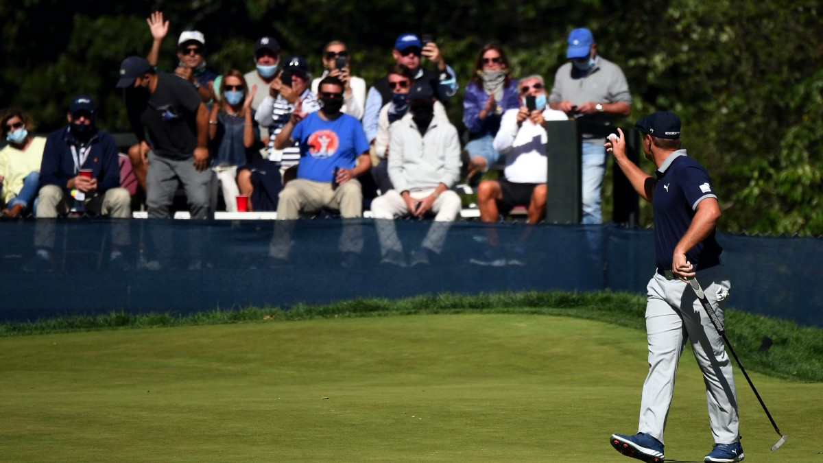 Bryson DeChambeau waves to the fans after putting out on the third green during the third round of the U.S. Open golf tournament at Winged Foot Golf Club - West.