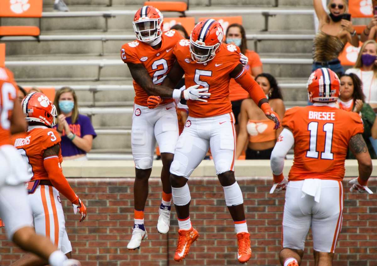 Clemson wide receiver Frank Ladson Jr. (2) and K.J. Henry(5) celebrate during their game Saturday, Sept. 19, 2020
