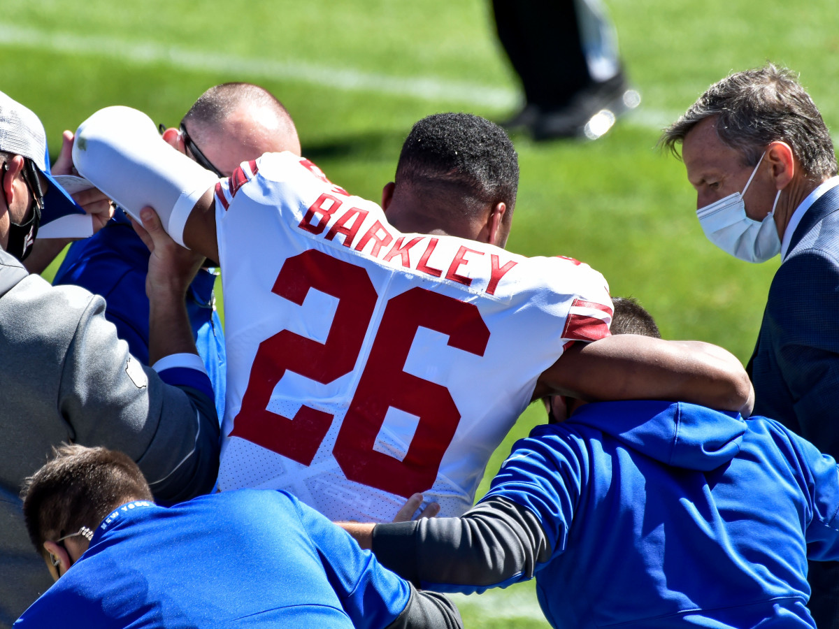 Sep 20, 2020; Chicago, Illinois, USA; New York Giants running back Saquon Barkley (26) is helped off the field after suffering an injury during the second quarter against the Chicago Bears at Soldier Field.
