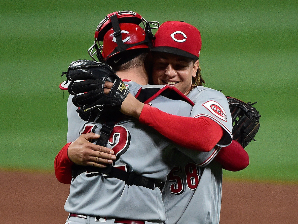 Luis Castillo hugs his catcher after a Reds win