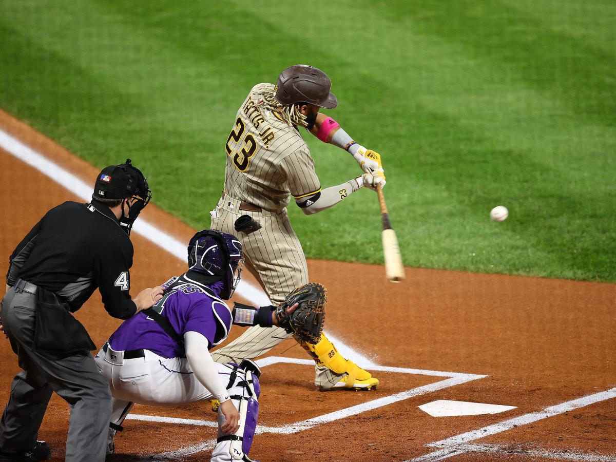 Fernando Tatis Jr. swings at a ball