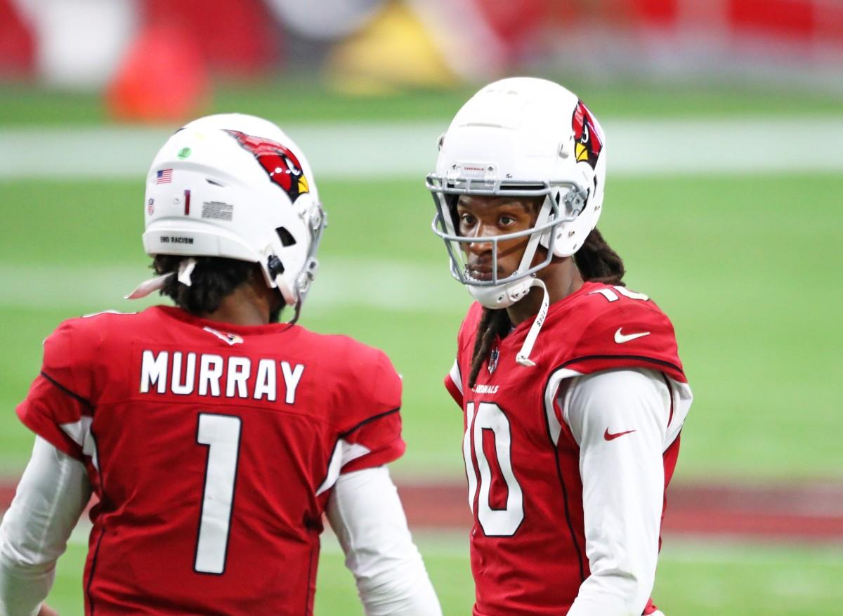 Arizona Cardinals quarterback Kyler Murray (1) with wide receiver DeAndre Hopkins (10) against the Washington Football Team at State Farm Stadium.
