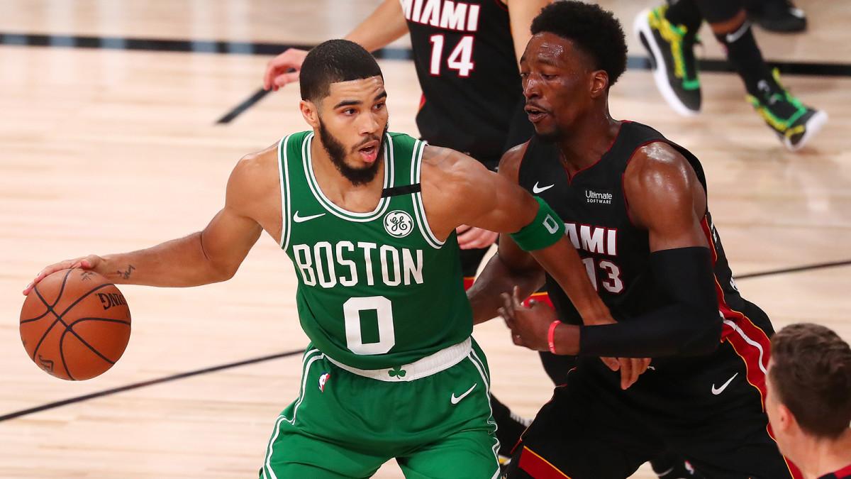 Boston Celtics forward Jayson Tatum dribbles the ball against Miami Heat forward Bam Adebayo