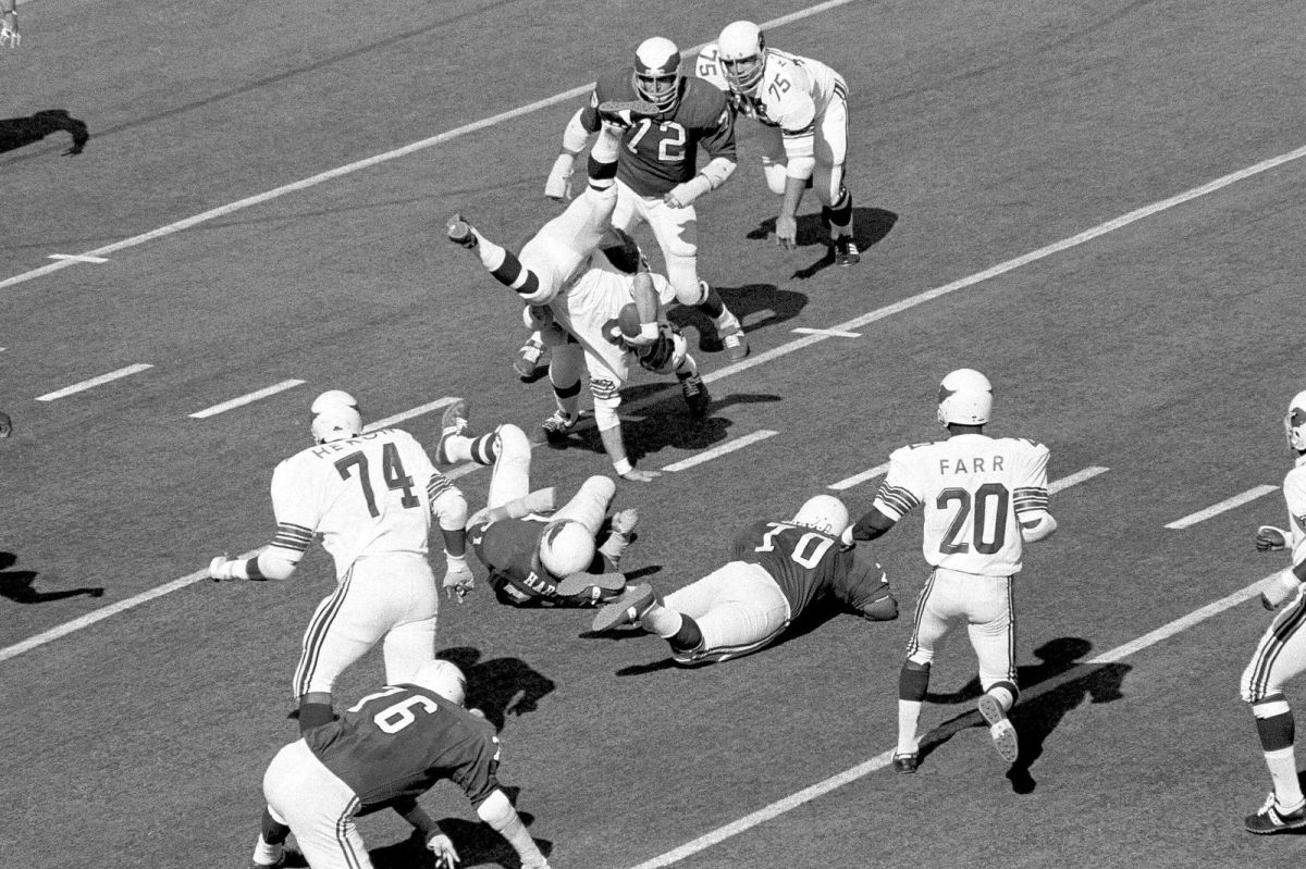 In this Oct. 18, 1970, file photo, St. Louis Cardinals safety Larry Wilson (8) winds up in a handstand after intercepting a Philadelphia Eagles pass and returning it 20 yards in the second period of a football game in Philadelphia. Wilson, a former Cardinals safety and member of the Pro Football Hall of Fame, has died. He was 82. Wilson died Thursday, Sept. 17, 2020, according to a news release from the team