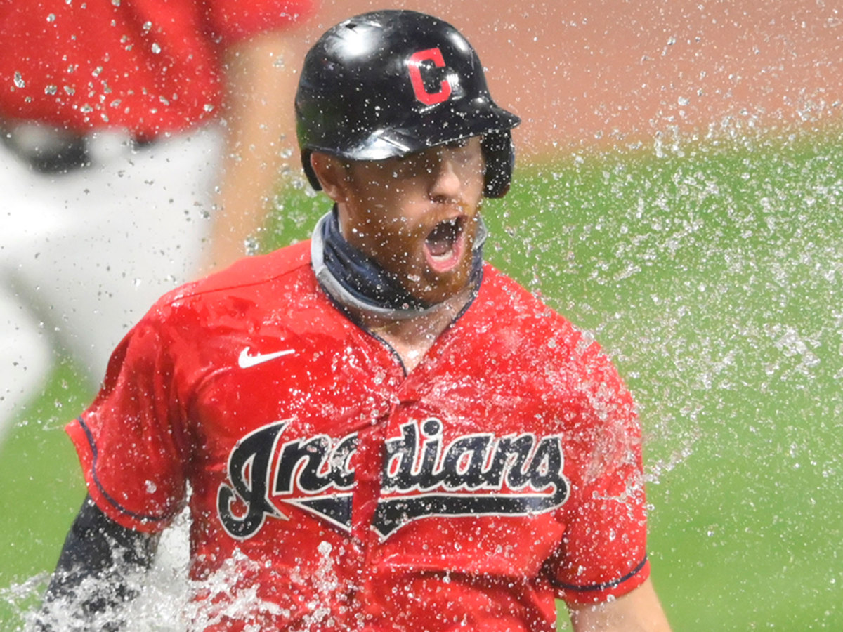 A Cleveland Indians player is splashed with water