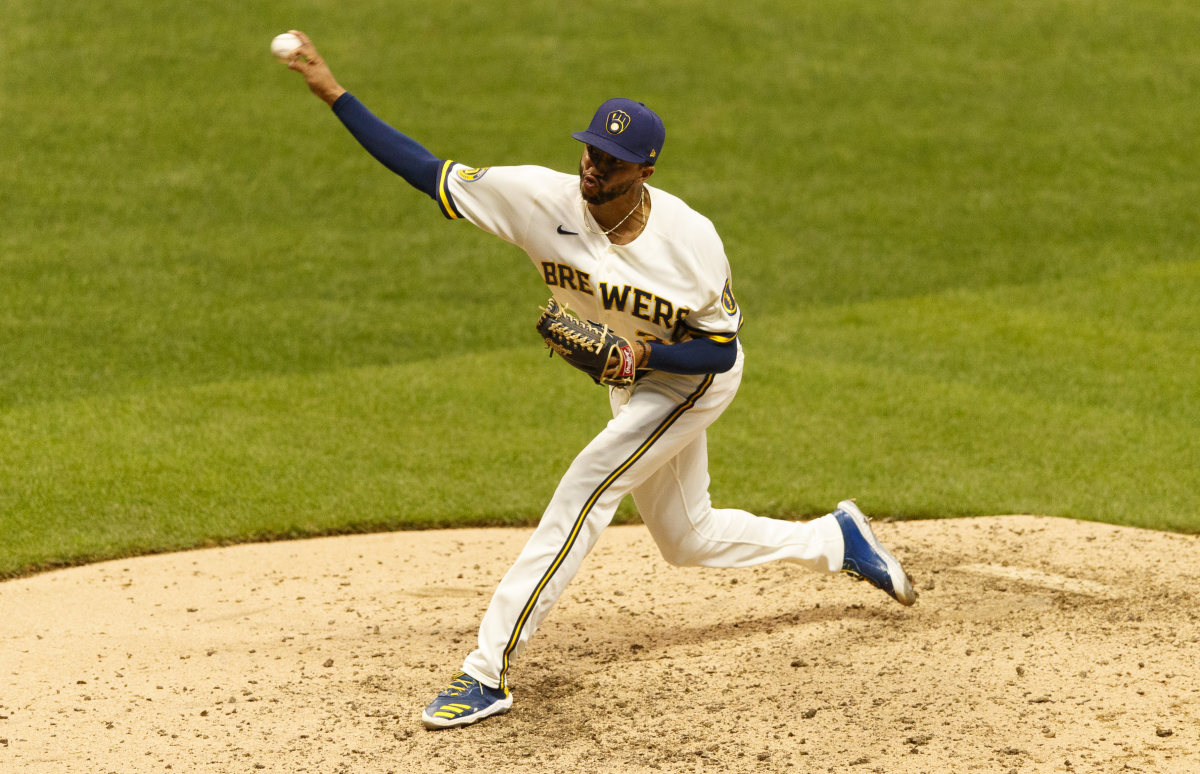 Milwaukee Brewers pitcher Devin Williams (38) throws a pitch during the eighth inning against the Cincinnati Reds at Miller Park.