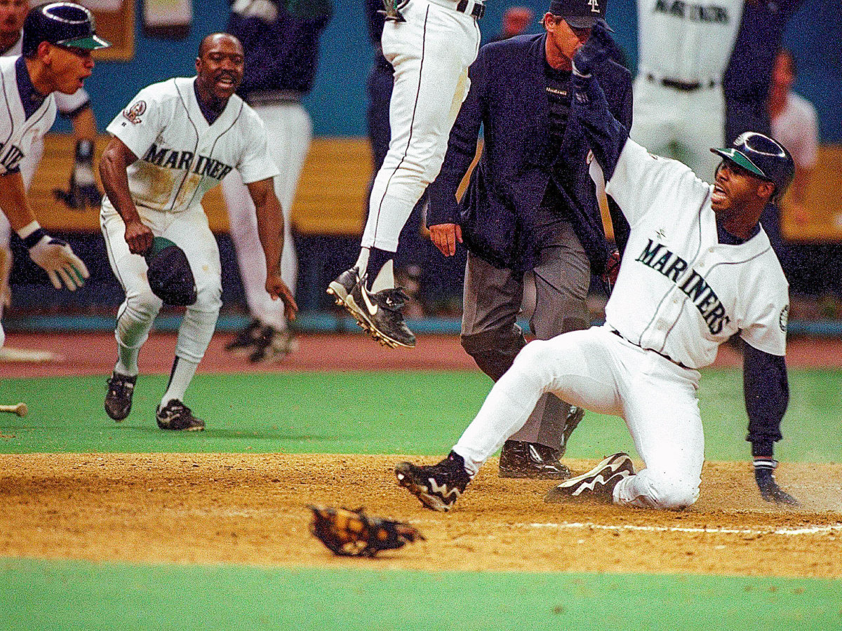 Ken Griffey Jr. slides into home