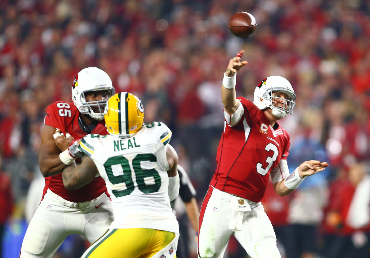 Former Cardinals quarterback Carson Palmer passes against the Packers during a 2015 NFC divisional round playoff game at University of Phoenix Stadium.
