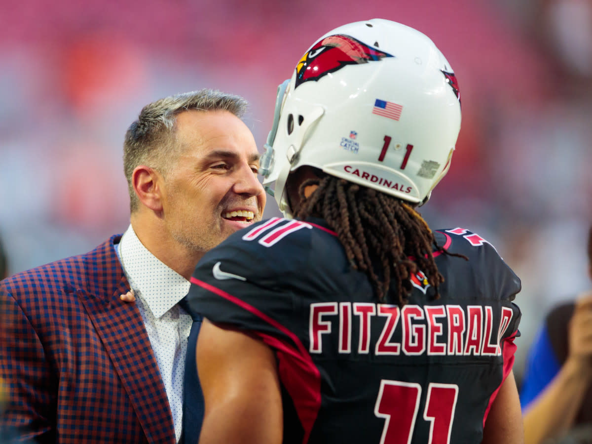 Former Cardinals quarterback and Hall of Famer Kurt Warner (left) talks with wide receiver Larry Fitzgerald prior to a 2018 game against the Broncos. Warner and Fitzgerald are the best in team history at their respective positions.