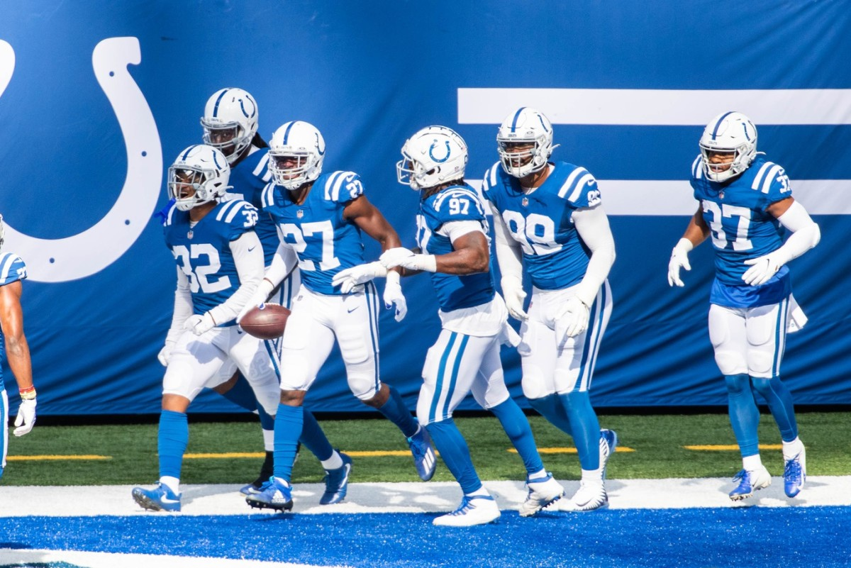 Cornerback Xavier Rhodes (27) celebrates with his Indianapolis Colts teammates after returning an interception 44 yards for a touchdown in Sunday's home rout of the N.Y. Jets.
