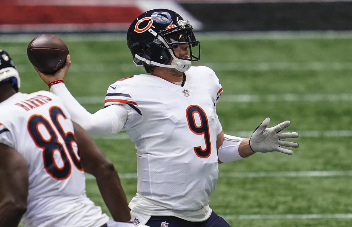 Chicago Bears quarterback Nick Foles (9) passes against the Atlanta Falcons during the third quarter at Mercedes-Benz Stadium.