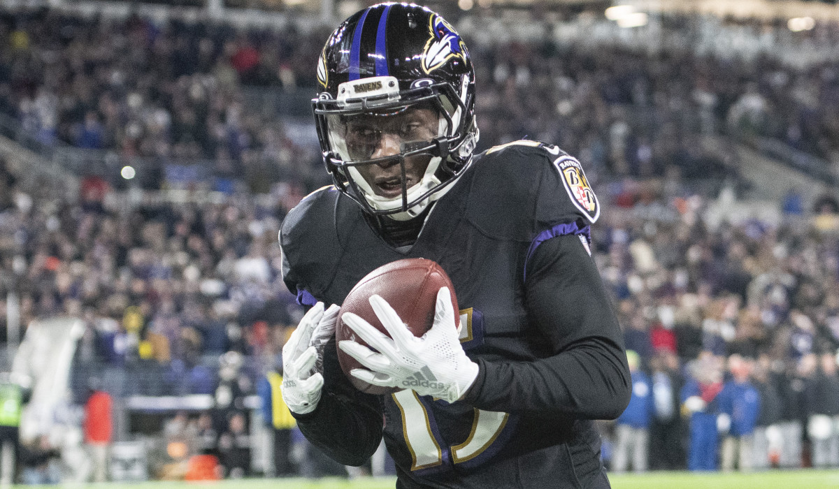 Baltimore Ravens wide receiver Marquise Brown (15) catches a pass for a touchdown during the third quarter against the New York Jets at M&T Bank Stadium.