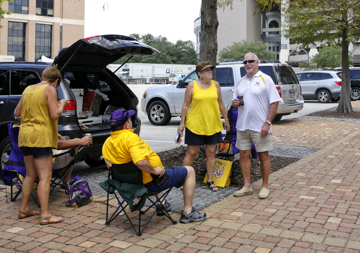 LSU fans sit in the parking lot near Tiger Stadium