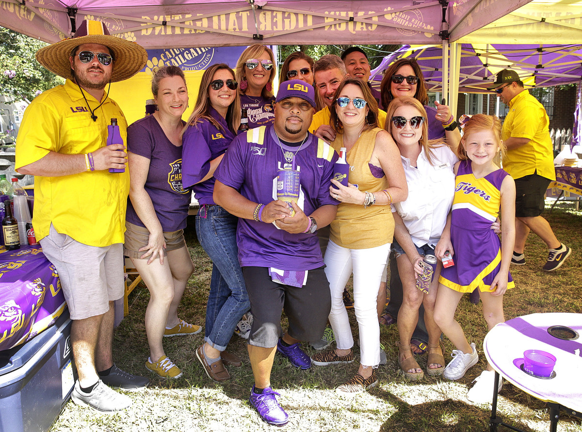 The Cajun Tiger Tailgating crew poses for a group photo during their tailgate Saturday in Baton Rouge.