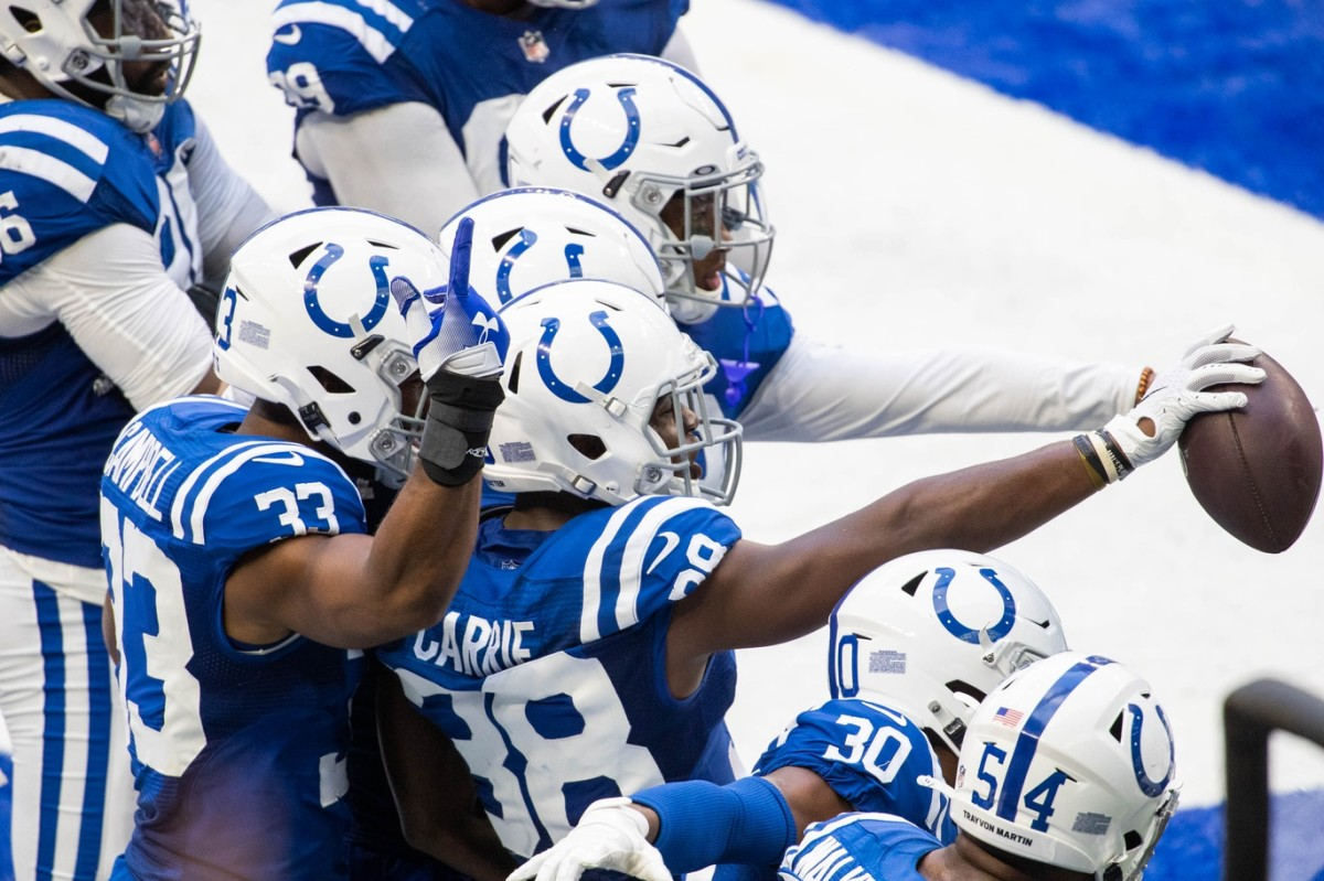 Indianapolis Colts cornerback T.J. Carrie (38) celebrates a pick-six score in Sunday's 36-7 home win over the N.Y. Jets.
