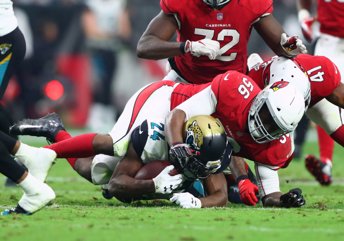 Cardinals linebacker Karlos Dansby (56) tackles Jaguars running back T.J. Yeldon (24) at University of Phoenix Stadium.