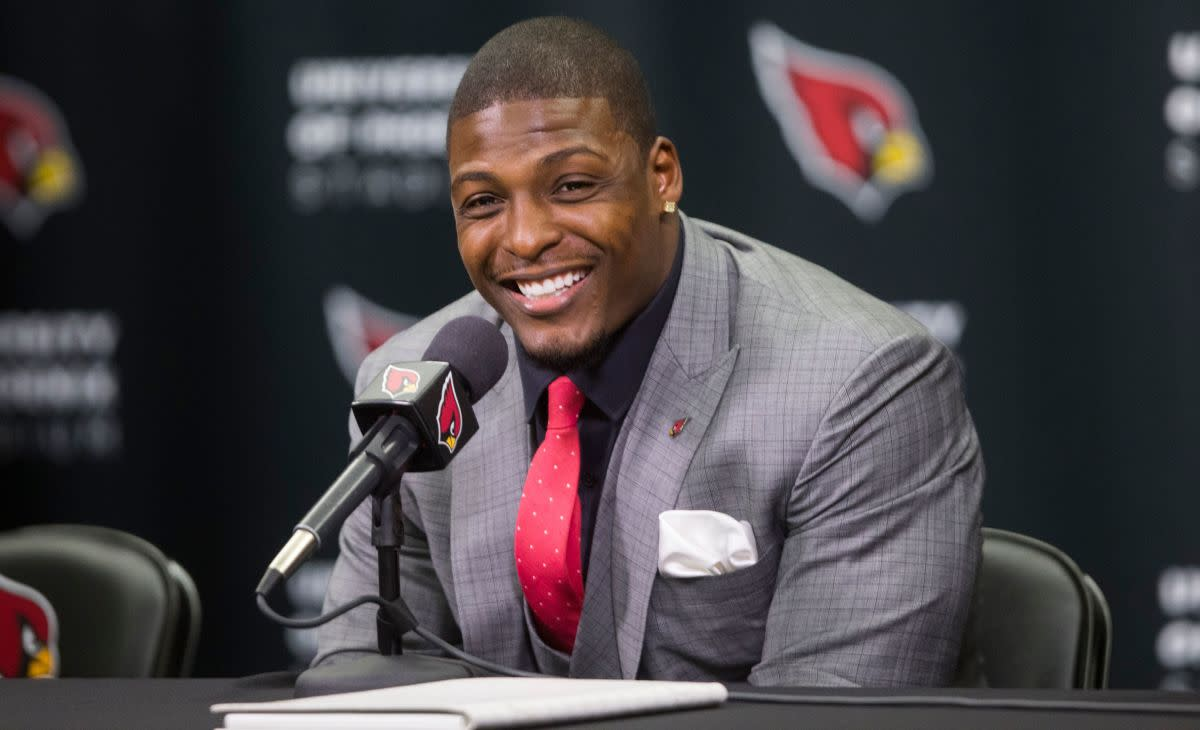 Adrian Wilson announces his retirement after signing a contract with the Cardinals at the Cardinals Training facility in Tempe on April 18, 2015.