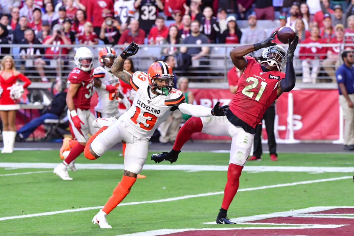 Cardinals cornerback Patrick Peterson (21) intercepts a pass intended for Browns wide receiver Odell Beckham Jr. (13) during a 2019 game at State Farm Stadium.