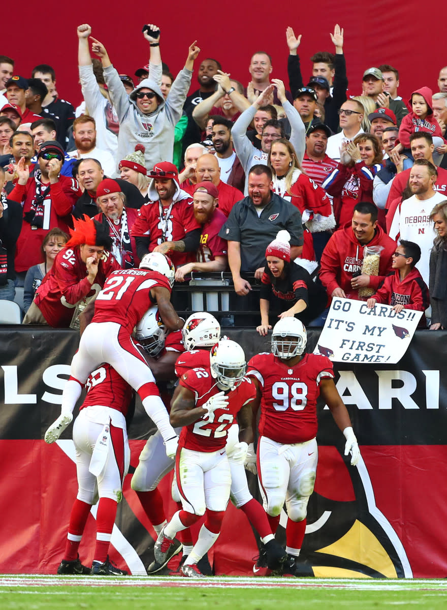 Cardinals players celebrate with defensive tackle Calais Campbell (93) after returning a fumble for a touchdown in the second quarter against the Saints at University of Phoenix Stadium.