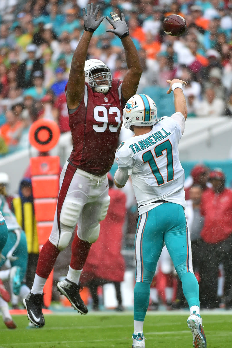 Cardinals defensive end Calais Campbell attempts to block Dolphins quarterback Ryan Tannehill's pass during a 2016 game at Hard Rock Stadium.