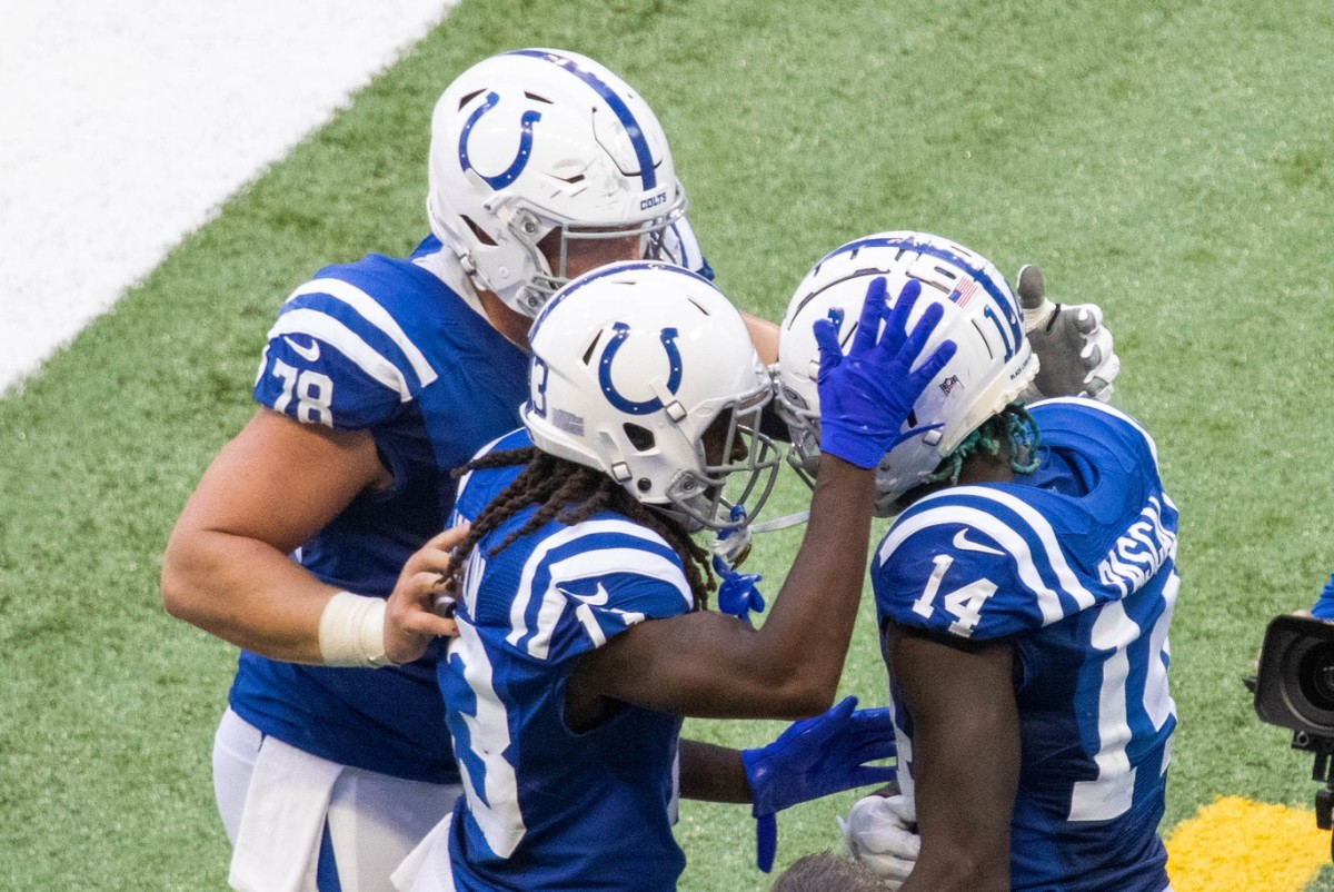 Indianapolis Colts wide receiver Zach Pascal (14) is congratulated by T.Y. Hilton (13) and Ryan Kelly (78) are catching a TD pass in Sunday's 36-7 home win over the New York Jets.