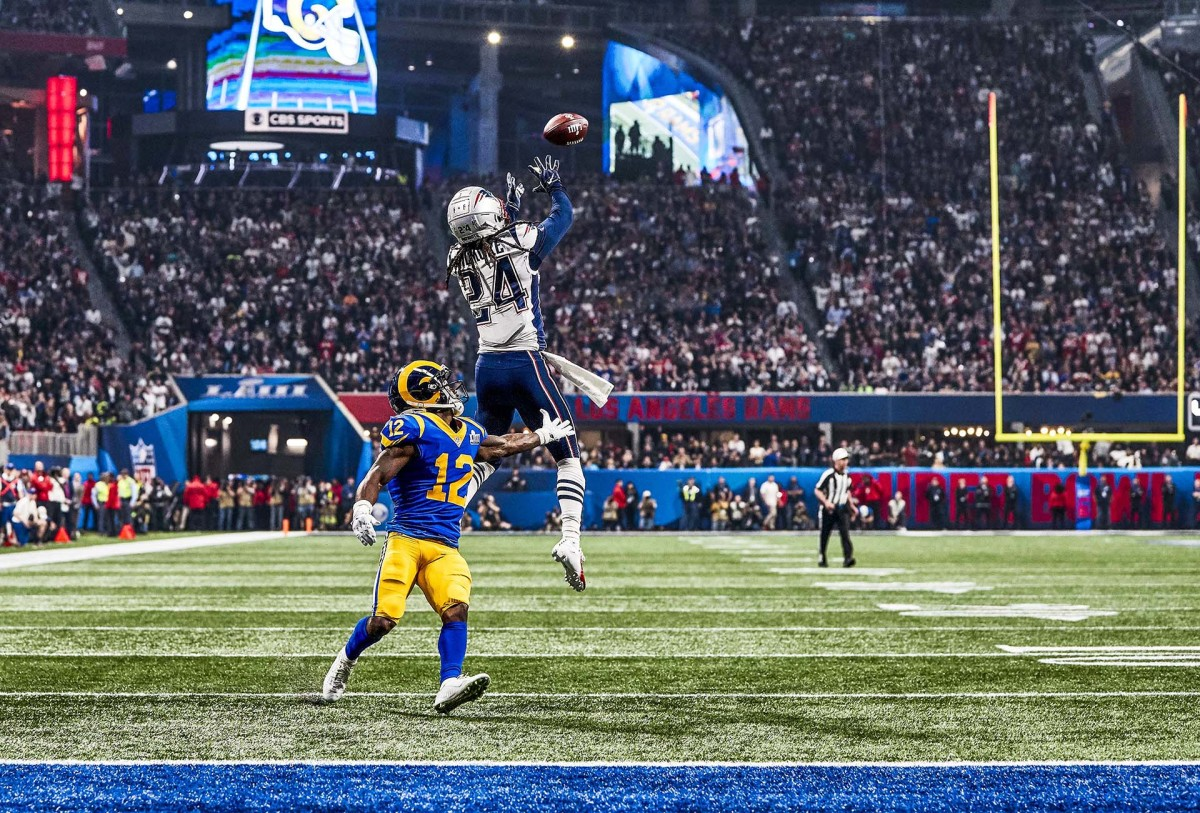 Stephon Gilmore leaps for an interception against the Rams in Super Bowl LIII