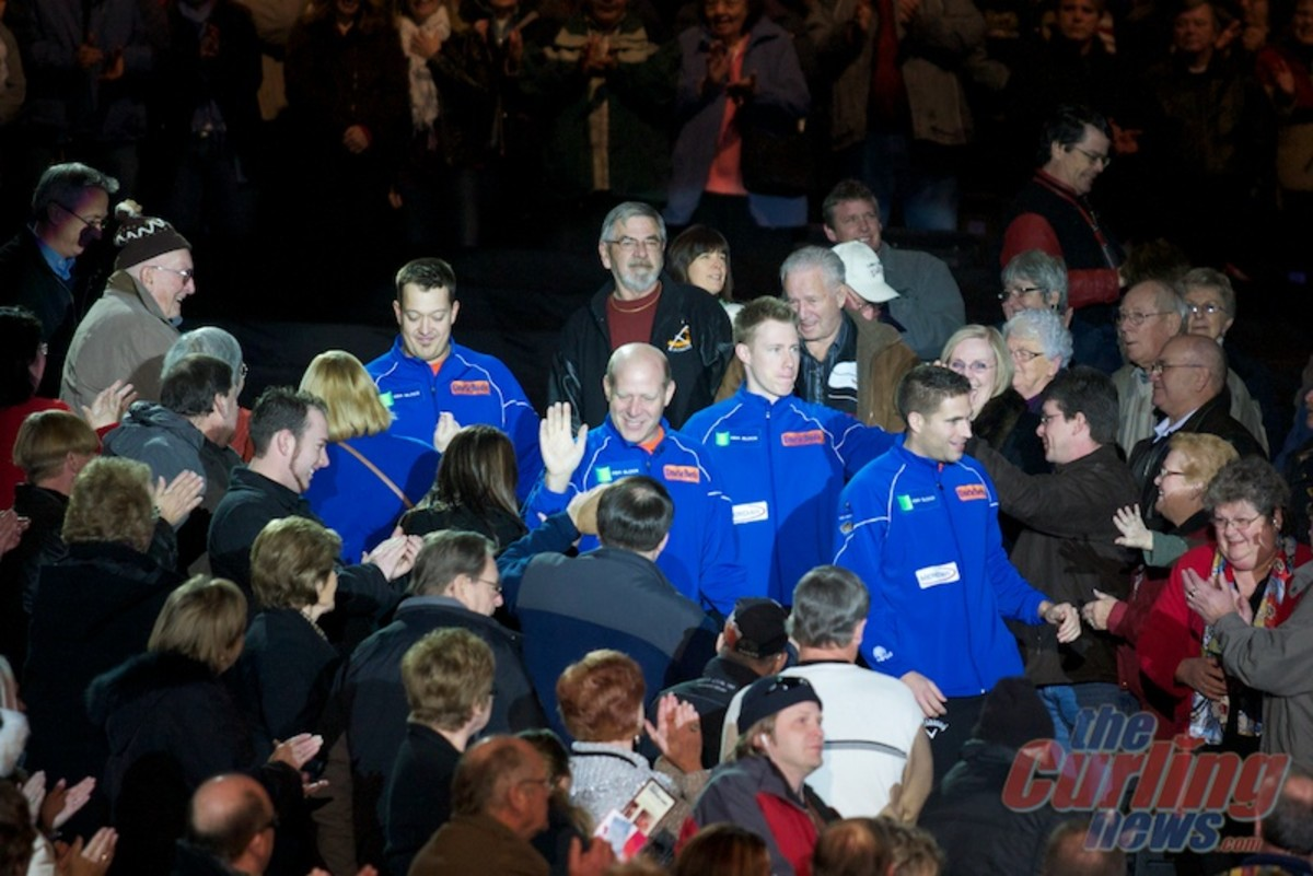 Team Martin during their crowd entrance. Is this boxing? Or darts?