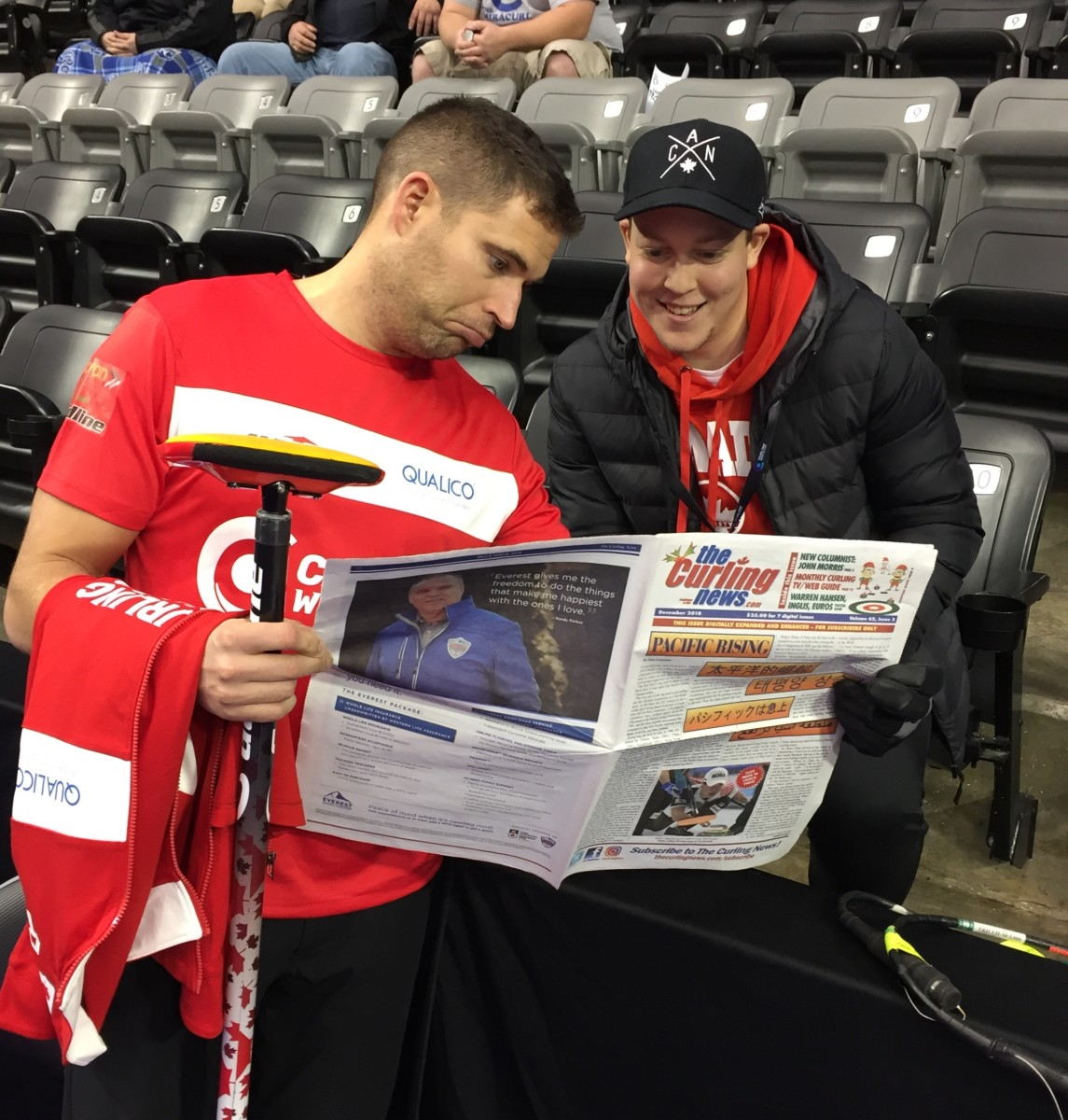 This is me showing John Morris his debut column in the December edition of The Curling News – first time he'd seen it. I'll see my first one in the January edition!