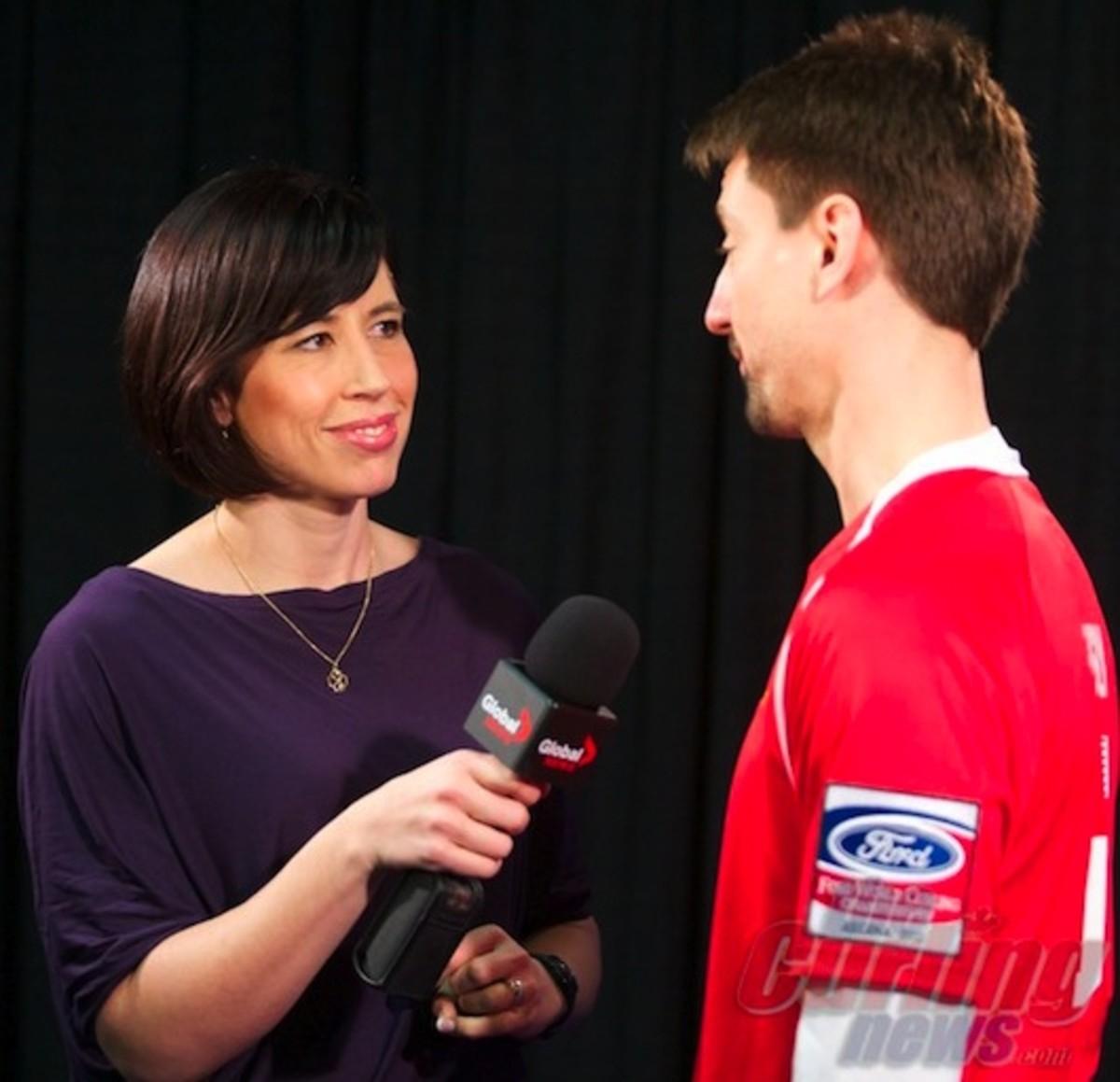 USA skip Pete Fenson and some attractive reporter