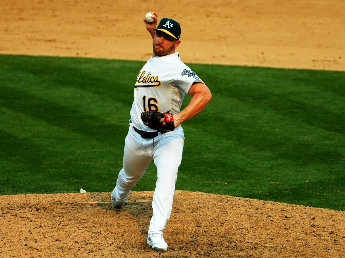 Oct 1, 2020; Oakland, California, USA; Oakland Athletics relief pitcher Liam Hendriks (16) pitches the ball during the ninth inning against the Chicago White Sox at Oakland Coliseum.