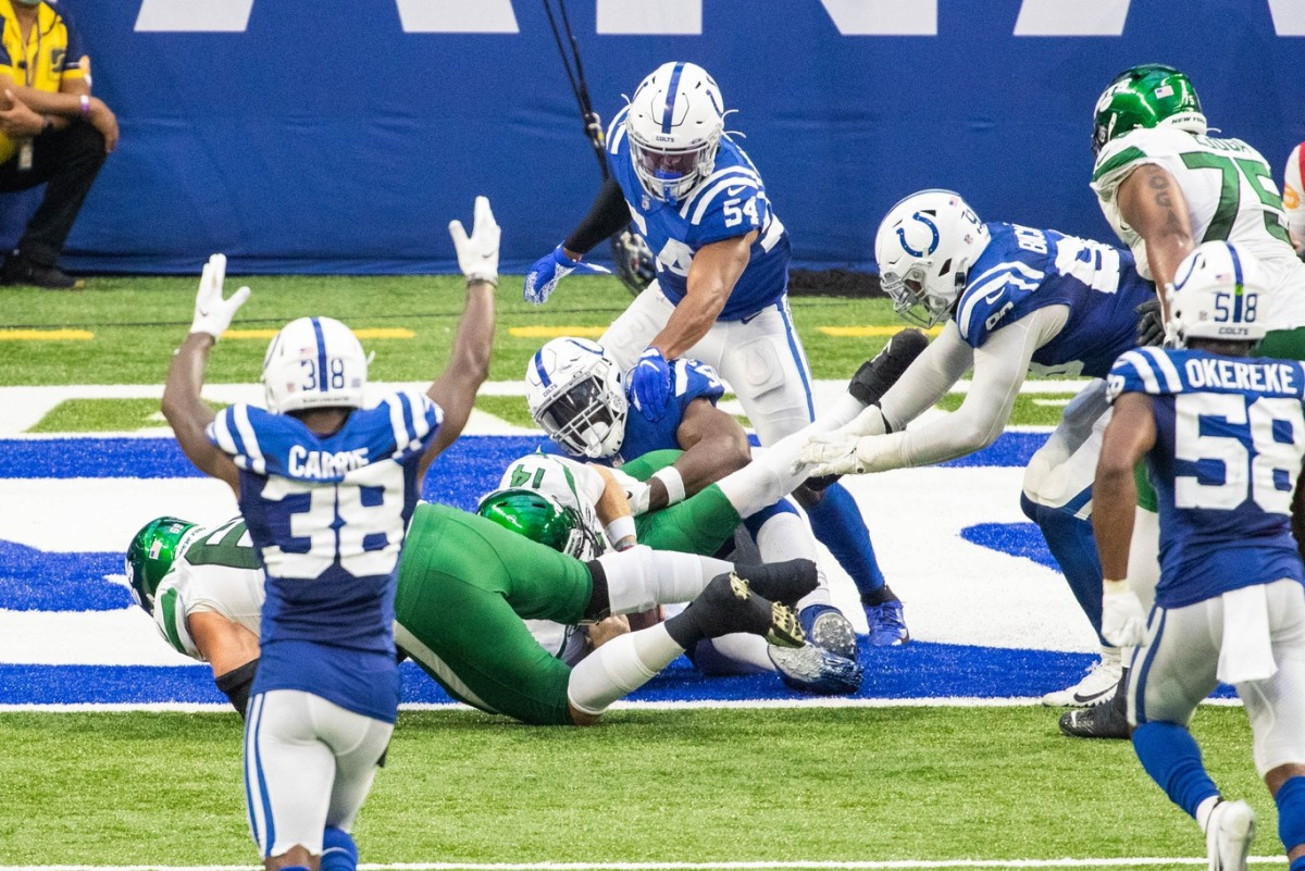 Indianapolis Colts defensive end Justin Houston tackles New York Jets quarterback Sam Darnold for a safety in Sunday's 36-7 home win at Lucas Oil Stadium.