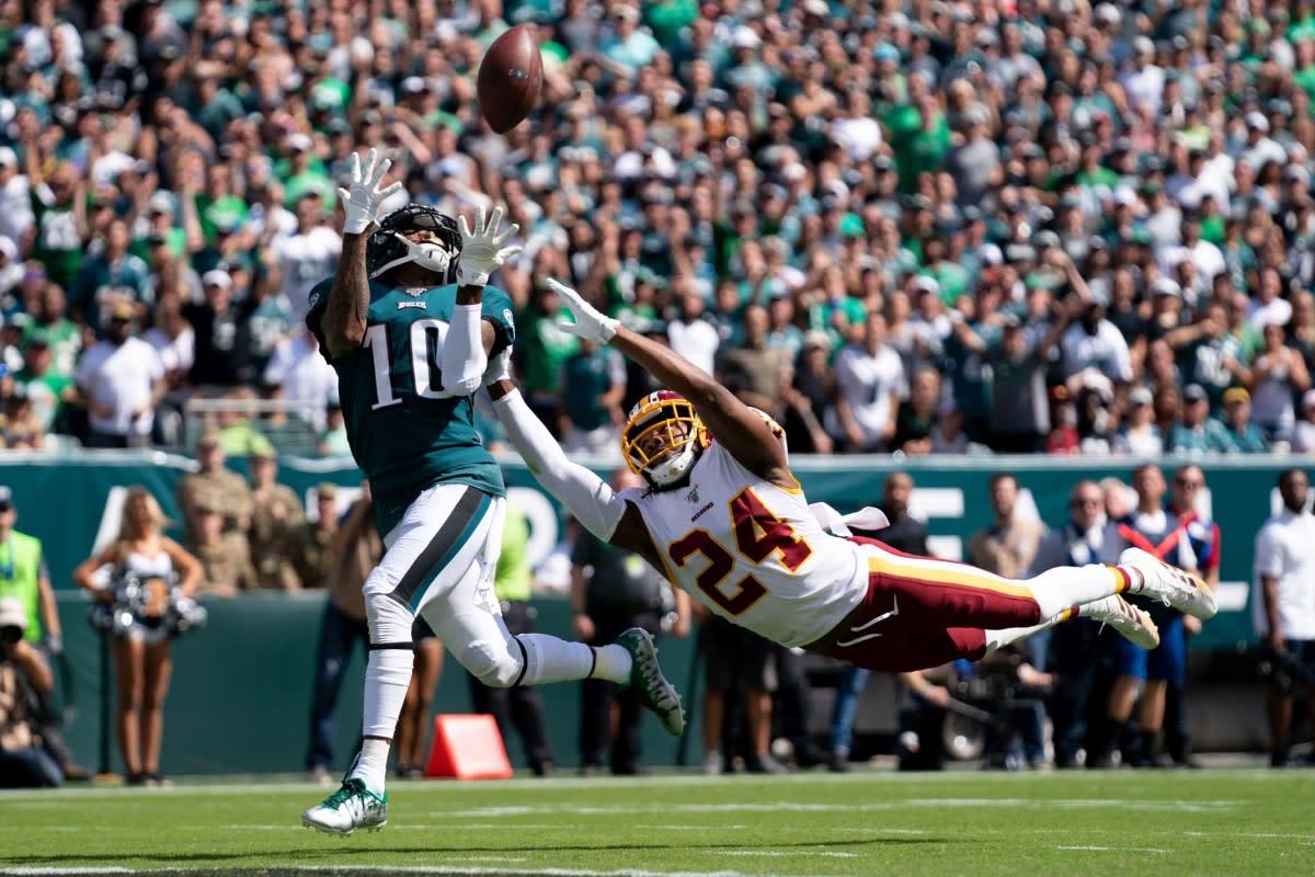 Philadelphia wide receiver DeSean Jackson (10) makes a 51-yard touchdown reception past Washington cornerback Josh Norman (24) during the second quarter at Lincoln Financial Field.