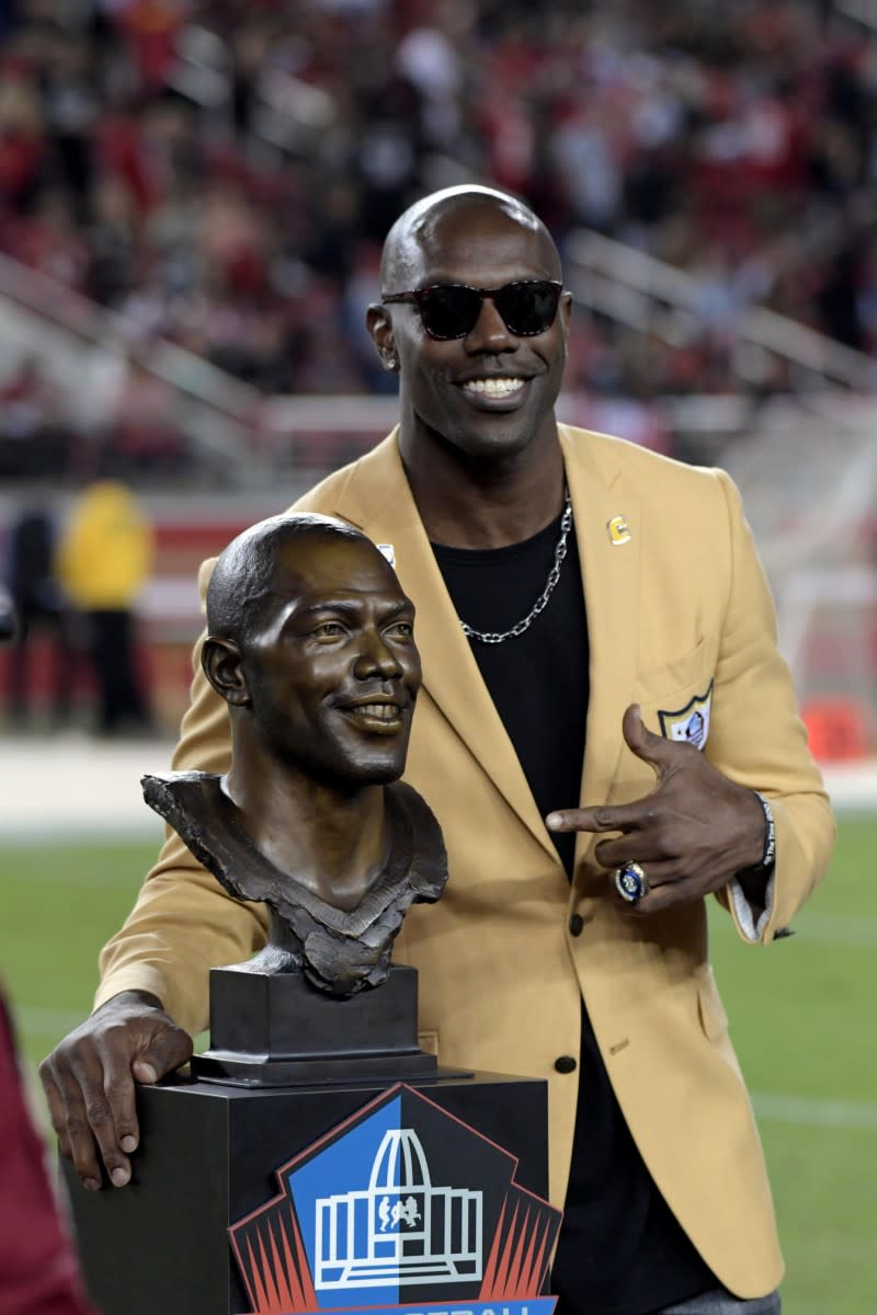 Terrell Owens, who was inducted into the Hall of Fame in 2018, smiles after being honored during a halftime presentation at Levi's Stadium.