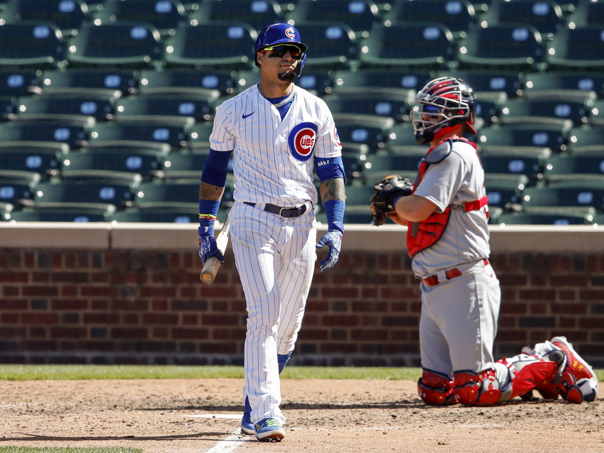 Aug 19, 2020; Chicago, Illinois, USA; Chicago Cubs shortstop Javier Baez (9) reacts after striking out against the St. Louis Cardinals during the fifth inning at Wrigley Field.