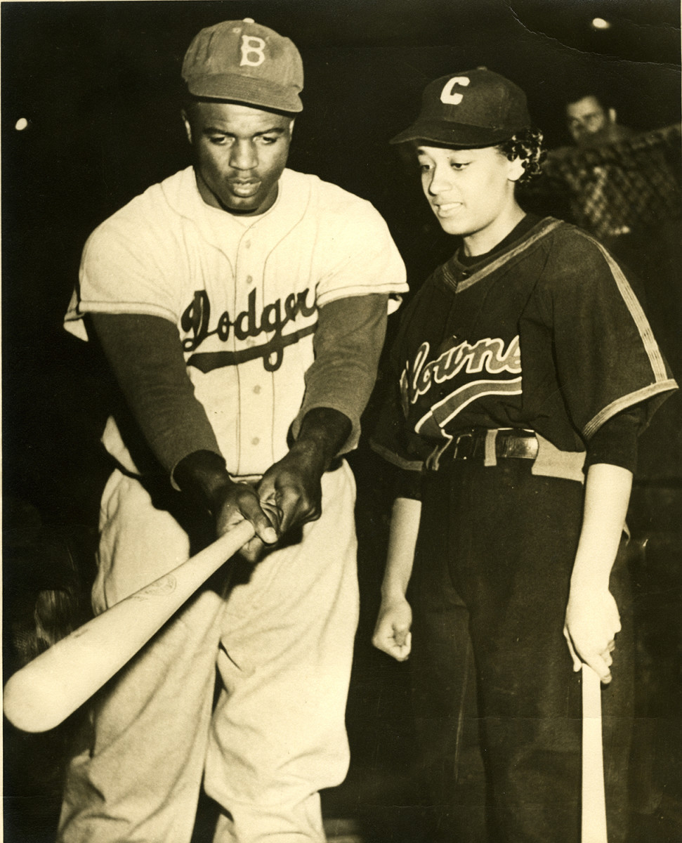 Morgan, with Jackie Robinson in 1954.